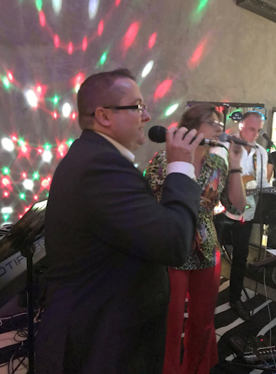 Having a live band at your wedding gives guests a chance to join in the entertainment